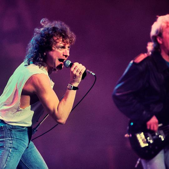 merican-based rock band Foreigner performs onstage during the Atlantic Records 40th Anniversary Concert at Madison Square Garden, New York, New York, May 14, 1988. Pictured are vocalist Lou Gramm and Rick Wills on bass guitar. (Photo by Paul Natkin/Getty Images)