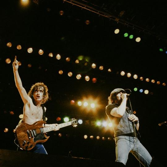 AC/DC Angus Young and Brian Johnson live at Nippon Budokan, Tokyo, June 10, 1982. (Photo by Koh Hasebe/Shinko Music/Getty Images)