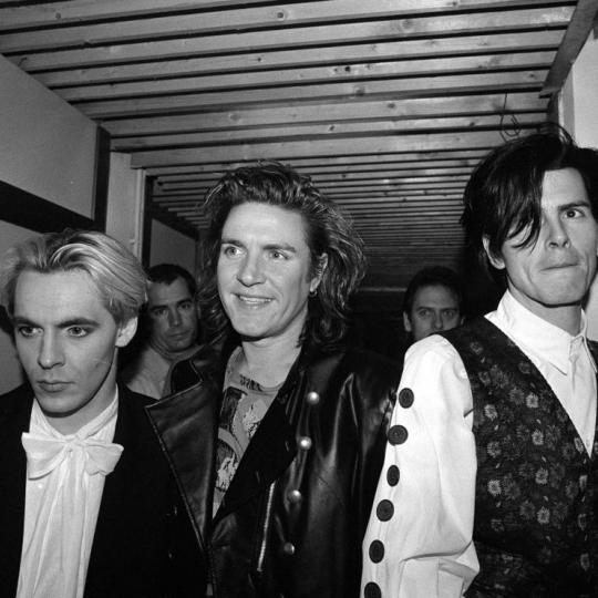 Members of the pop group Duran Duran, who took Milan by storm last night, as 1,000 screaming fans greeted them before they played. From left: Nick Rhodes, Simon Le Bon and John Taylor (Photo by PA Images via Getty Images)