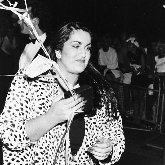 Melanie Panayiotou, sister of singer George Michael, holding balloons as she attends the 'Wham!' farewell party, London, July 8th 1986. (Photo by Dave Hogan/Getty Images) *