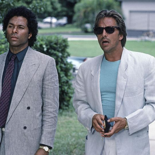 """The Dutch Oven"" Episode 4 -- Air Date 10/25/1985 -- Pictured: (l-r) Philip Michael Thomas as Detective Ricardo 'Rico' Tubbs, Don Johnson as Detective James 'Sonny' Crockett (Photo by NBCU Photo Bank/NBCUniversal via Getty Images via Getty Images)"
