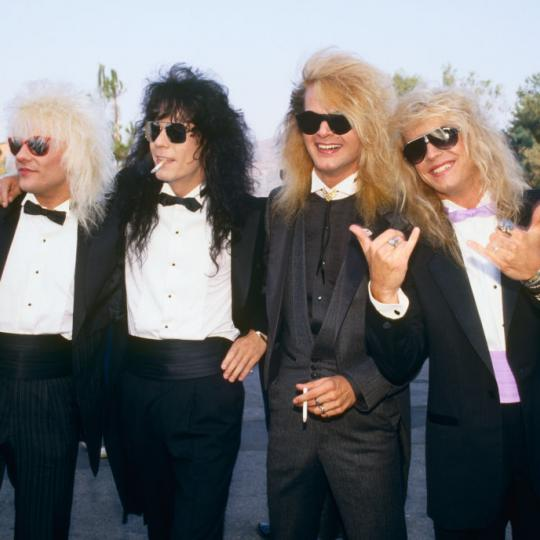 Members of the rock group Poison, Bret Michaels, C.C. DeVille, Rikki Rockett and Bobby Dall, pose on the red carpet at the 1987 Universal City, California, MTV Music Video Awards. (Photo by George Rose/Getty Images)