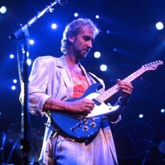 English guitarist, songwriter, and singer who co-founded the rock band Genesis, Mike Rutherford performs onstage at the Joe Louis Arena during the first show of the band's Invisible Touch Tour, on September 18, 1986, in Detroit, Michigan. (Photo by Ross Marino/Getty Images)