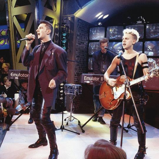 GERMANY - 1st JANUARY: Dave Gahan and Martin Gore (right) from Depeche Mode perform live on a TV show in Germany in 1987. Emulator II keyboard being played behind. (Photo by Martina Raddatz/Redferns)