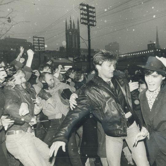 December 1985: Bodyguards restraing fans as Nick Rhodes makes a mad dash into the CITY-TV studios. He was there promoting the Arcadia album (Tony Bock/Toronto Star via Getty Images)