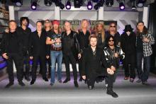 (L-R) Rick Allen, Tommy Lee, Vivian Campbell, Joe Elliott, Bret Michaels, Phil Collen, Rick Savage, Rikki Rockett, C.C. DeVille, Nikki Sixx, Vince Neil, Mick Mars, and Bobby Dall attend the Press Conference with Mötley Crüe, Def Leppard, and Poison announcing 2020 Stadium Tour on December 04, 2019 in Hollywood, California. (Photo by Kevin Winter/Getty Images)