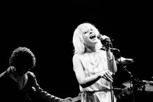 Debbie Harry in concert with Blondie, at the Odeon, Birmingham, part of their European Tour 1979-'80. 7th January 1980. (Photo by Staff/Mirrorpix/Getty Images)