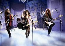 Photo of BANGLES and Vicki PETERSON and Susanna HOFFS and Michelle STEELE; L-R Vicki Peterson, Susanna Hoffs and Michelle Steele performing on a tv show (Photo by  Photo of BANGLES and Vicki PETERSON and Susanna HOFFS and Michelle STEELE; L-R Vicki Peterson, Susanna Hoffs and Michelle Steele performing on a tv show (Photo by Bernd Muller/Redferns)
