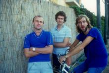 Portrait of the British singer Phil Collins, the British keyboards player Tony Banks and the British bassist and guitarist Mike Rutherford on a bike. They having a role in the British musical band called Genesis. 1981 (Photo by Angelo Deligio/Mondadori via Getty Images)