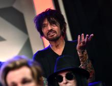 LOS ANGELES, CALIFORNIA - DECEMBER 04: Tommy Lee of M?tley Cr?e speaks during the press conference for THE STADIUM TOUR DEF LEPPARD - MOTLEY CRUE - POISON at SiriusXM Studios on December 04, 2019 in Los Angeles, California. (Photo by Emma McIntyre/Getty Images for SiriusXM)