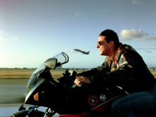 "LOS ANGELES - MAY 16: The movie ""Top Gun"", directed by Tony Scott. Seen here, Tom Cruise as Lt. Pete ""Maverick"" Mitchell riding a Kawasaki GPZ 900 R. Initial theatrical release May 16, 1986. Screen capture. Paramount Pictures. (Photo by CBS via Getty Images)"