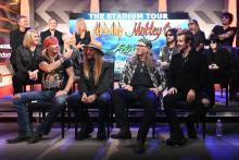 ) Rick Allen, Joe Elliott, Vivian Campbell, Phil Collen, and Rick Savage of Def Leppard, Nikki Sixx, Vince Neil, Mick Mars, and Tommy Lee of Mötley Crüe, and (Front of stage L-R) Bret Michaels, C.C. DeVille, Bobby Dall, and Rikki Rockett of Poison attend the Press Conference with Mötley Crüe, Def Leppard, and Poison announcing 2020 Stadium Tour on December 04, 2019 in Hollywood, California.