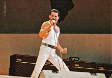 ULY 13: Freddie Mercury of Queen performs on stage at Live Aid on July 13th, 1985 in Wembley Stadium, London, England