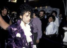 "HOLLYWOOD - JULY 26: Musician Prince attending the premiere of ""Purple Rain"" on July 26, 1984 at Mann Chinese Theater in Hollywood, California. (Photo by Ron Galella, Ltd./Ron Galella Collection via Getty Images)"