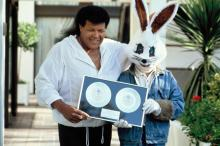 Chubby Checker and Jive Bunny accept sales awards in England in 1989.