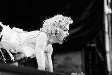 Madonna, vocal performs at the Feijenoord Stadium with Blonde ambition tour in Rotterdam, the Netherlands on 24th July 1990. (Photo by Frans Schellekens/Redferns)