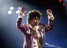 DETROIT, MI - NOVEMBER 4: American singer, songwriter, musician, record producer, dancer, actor, and filmmaker Prince (1958-2016) performs onstage during the 1984 Purple Rain Tour on November 4, 1984, at the Joe Louis Arena in Detroit, Michigan. (Photo by Ross Marino/Getty Images)