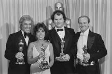 "L-R: Burt Bacharach, Carole Bayer Sager, Christopher Cross and Peter Allen win Oscars for ""Arthur's Theme (Best That You Can Do)."""