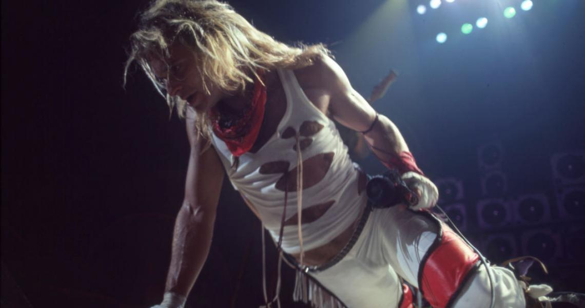 "DETROIT - JULY 3: American rock vocalist, musician, songwriter and original lead singer of Van Halen, David Lee Roth, performs during the band's ""Fair Warning Tour"" on July 3, 1981, at Cobo Arena in Detroit, Michigan. (Photo by Ross Marino/Getty Images)"