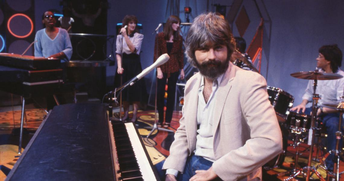 Michael McDonald poses for the camera on the Soul Train stage in between takes during the videotaping of episode 408, aired 12/18/1982. (Photo by Soul Train via Getty Images).