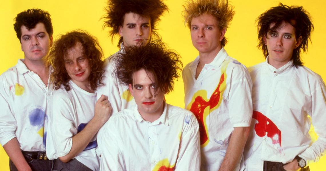 DETROIT, MI - JULY 30: (L-R) Drummer and keyboardist Lol Tolhurst, bass guitarist Porl Thompson, bassist Simon Gallup, English singer, songwriter and musician Robert Smith, drummer Boris Williams and keyboardist Roger O'Donnell of The Cure pose for a studio portrait during The Kissing Tour on July 30, 1987 at the Cobo Arena in Detroit, Michigan. (Photo by Ross Marino/Getty Images)