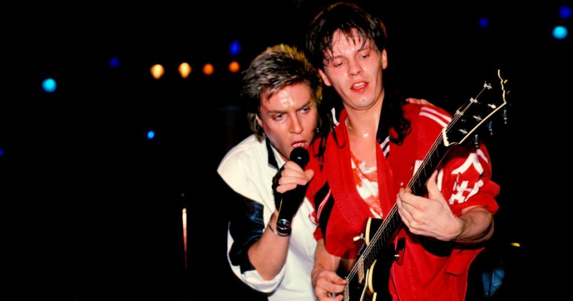 Simon Le Bon and Andy Taylor at Live Aid, 1985