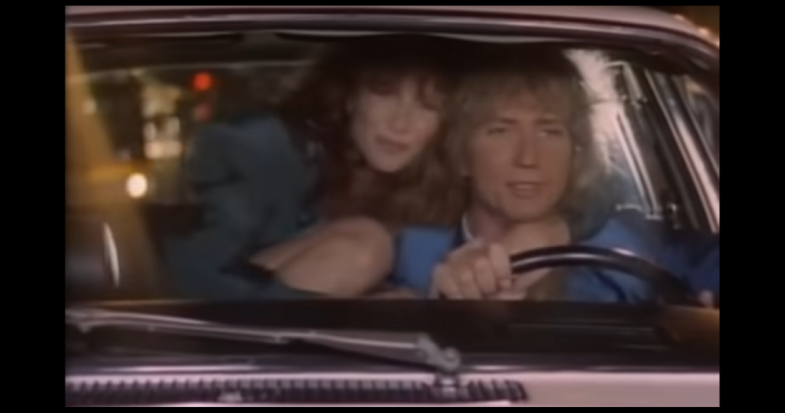 "Tawny Kitaen and David Coverdale in the ""Here I Go Again"" video"